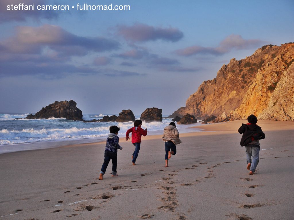 boys running on a beach